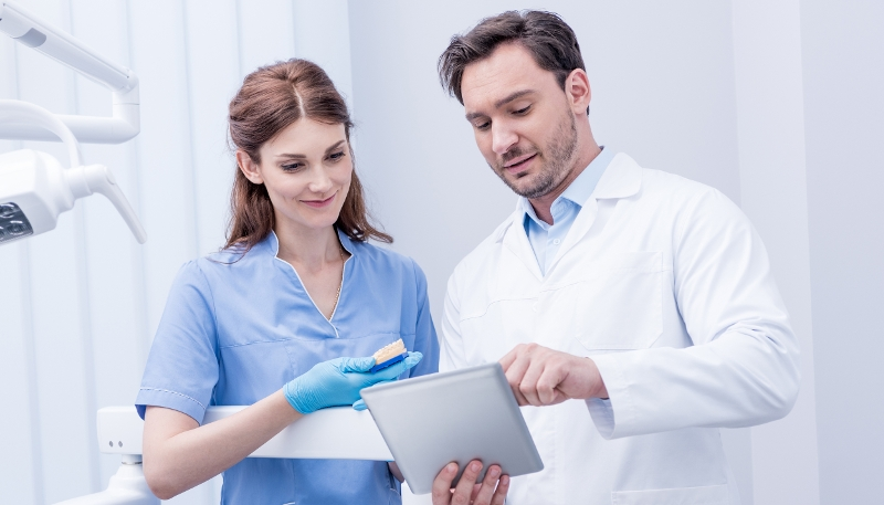 Two dentists reviewing results